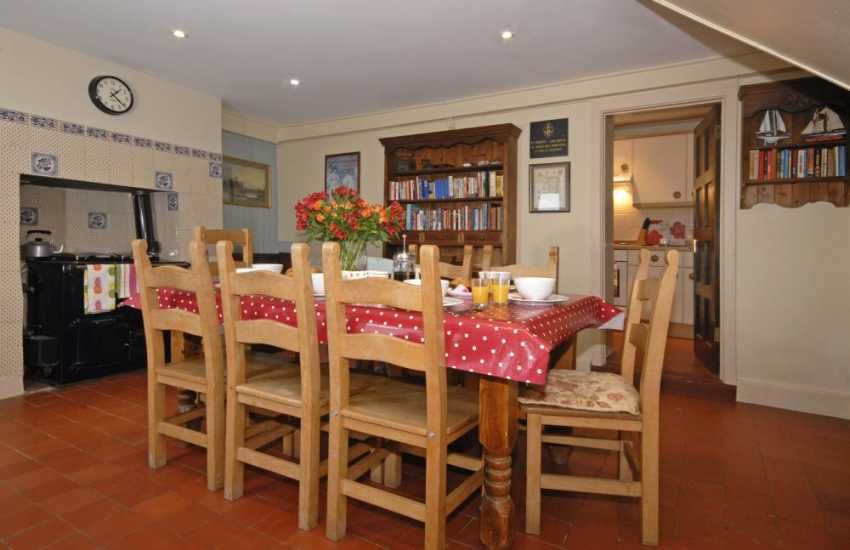 Whitesands Bay holiday home - dining room with oil fired Rayburn