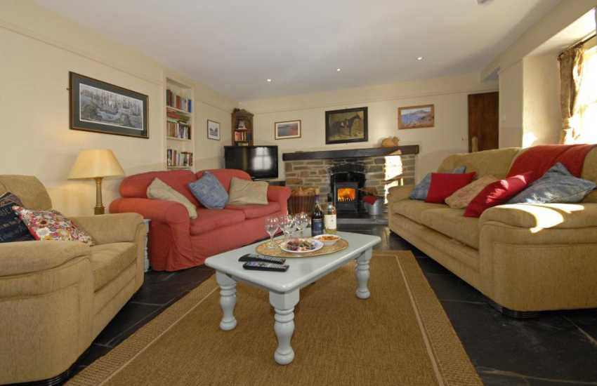 Whitesands, Pembrokeshire holiday cottage - cosy sitting room with wood burning stove