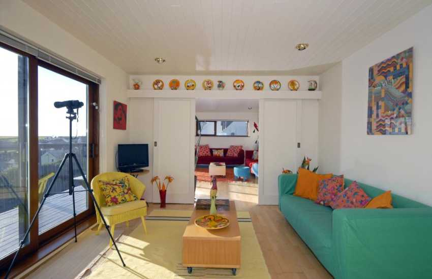 St Davids, holiday home on the Pembrokeshire coast - sitting room with patio doors to balcony