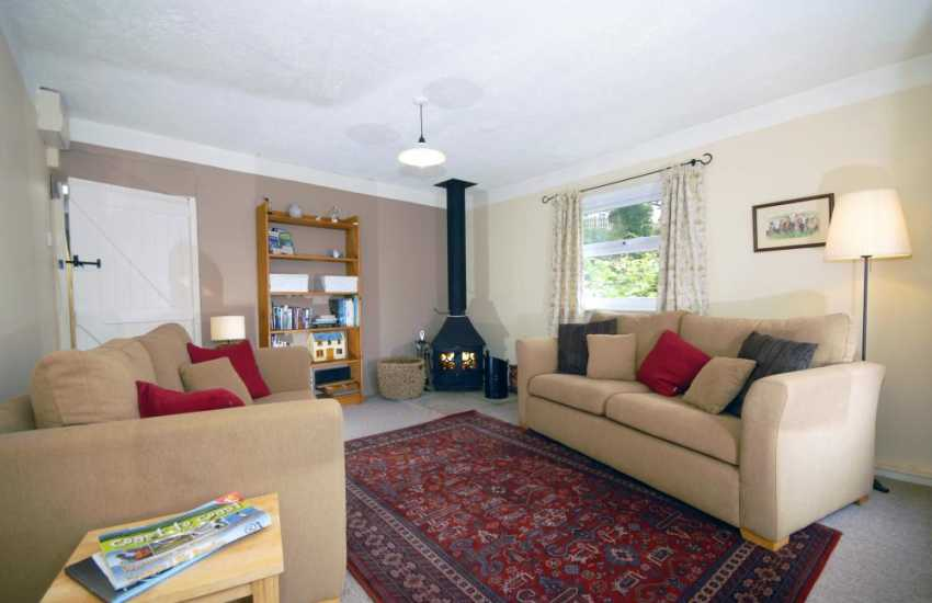 Solva holiday cottage - sitting room with multi-fuel stove