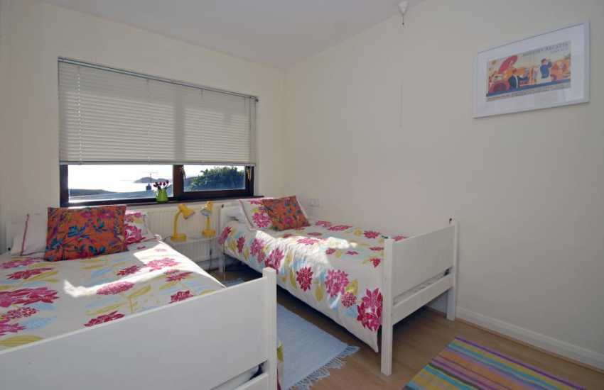 North Pembrokeshire holiday home sleeping 8 - twin bedroom with sea views