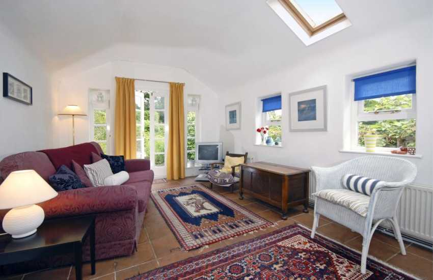 Pembrokeshire coastal cottage - sunroom with french doors to the garden, patio, and deck