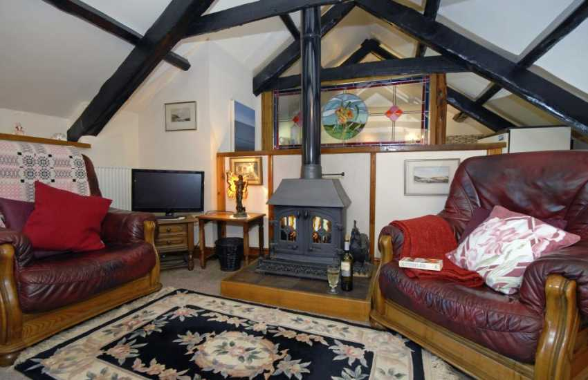 Cardigan Bay Heritage Coast holiday cottage - first floor lounge with log-burning stove