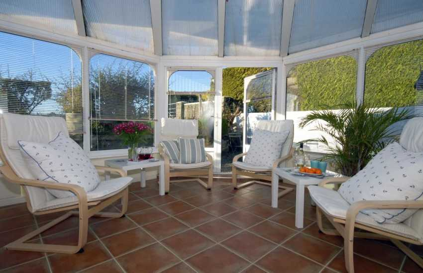 Wolfs Castle holiday cottage - sunroom with French doors to small garden