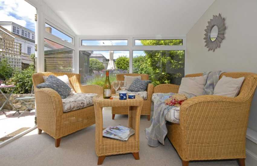 Aberaeron family holiday home - sun room over looking the patio