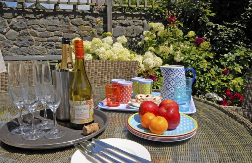 Relax alfresco on the sunny patio at Harbour House Aberaeron