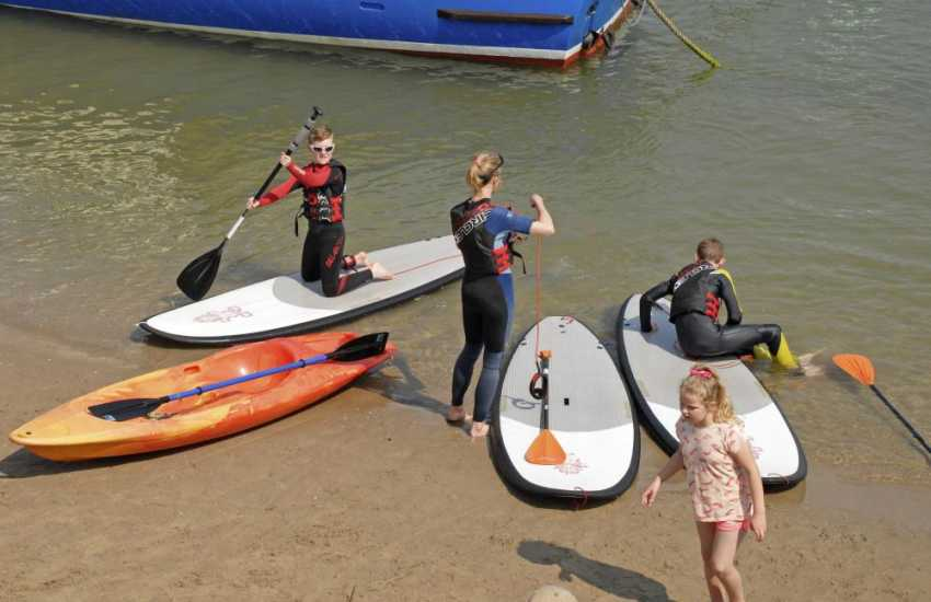 Plunge into Pembrokeshire surf. Try sea kayaking or paddle boarding in the crystal clear water - its great fun!