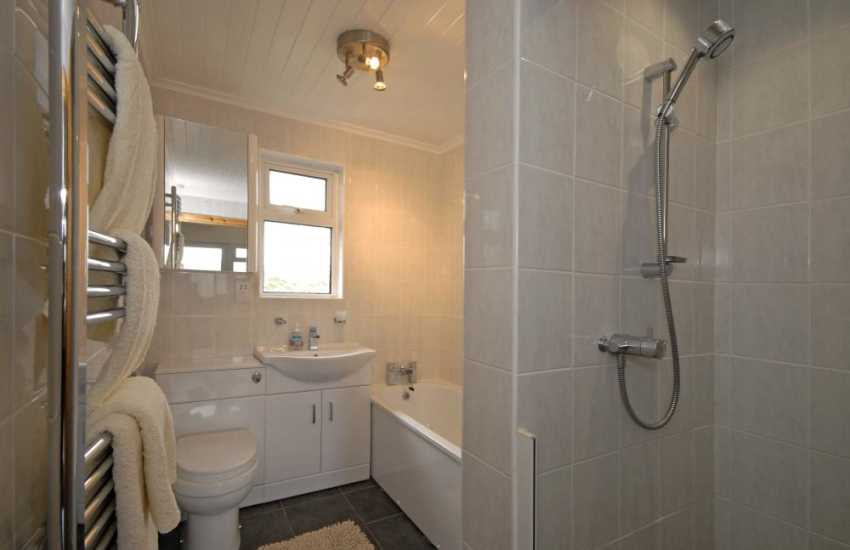 Ground floor bathroom with separate walk in shower