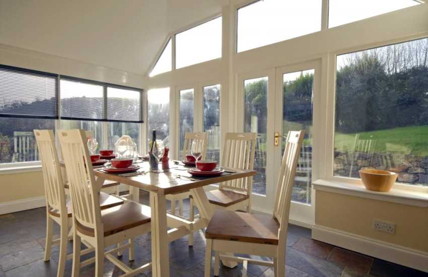 Martins Haven cottage - dining room with garden views