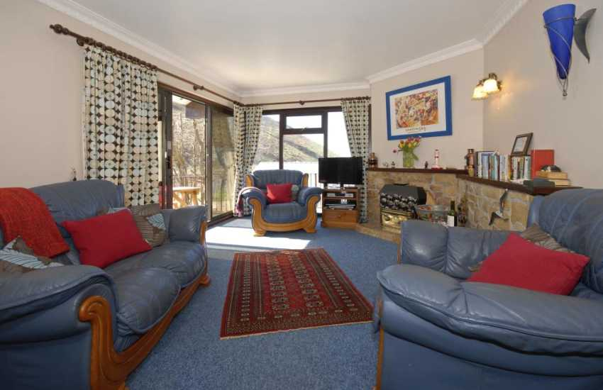 Cwm Tydu coast holiday bungalow - sitting room with terrace and valley views