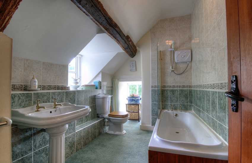Bathroom on first floor with bath and shower over
