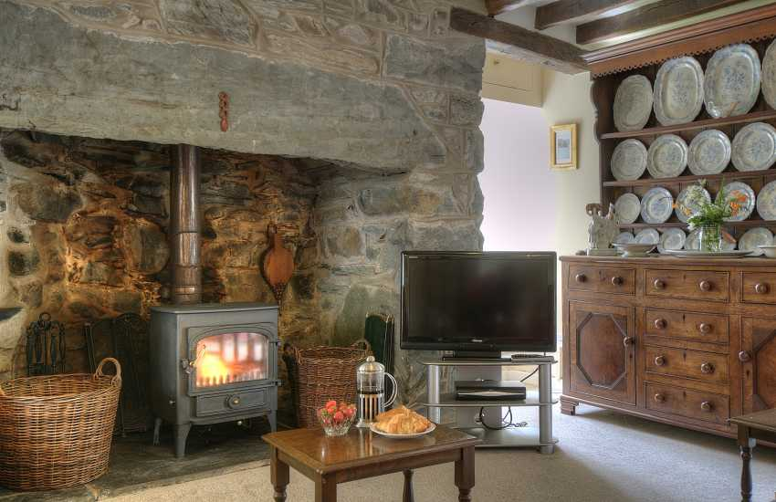 Lounge with wood-burner in rural Welsh cottage