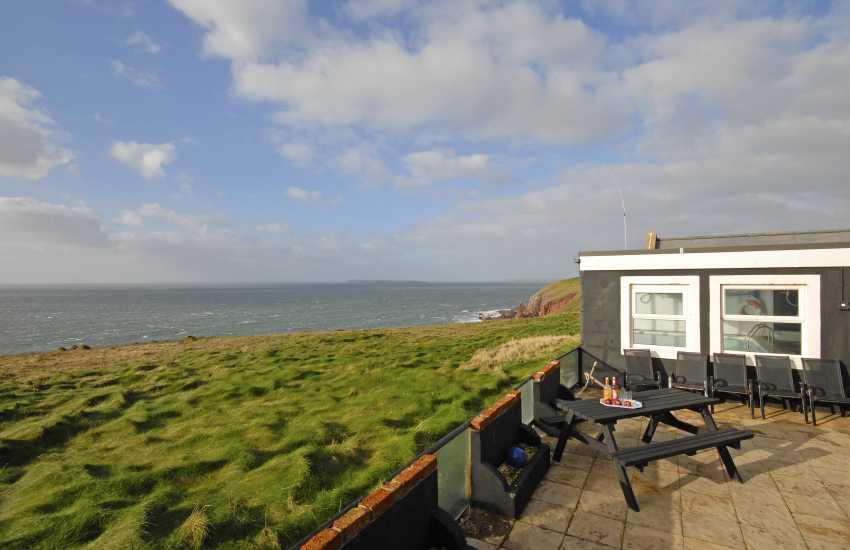 Dale unique holiday home - patio with coastal views