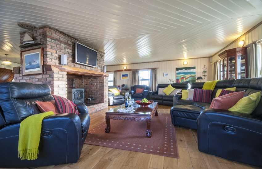 Dale, Pembrokeshire lighthouse - spacious open plan sitting area with electric stove