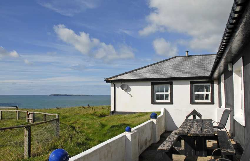 Dale coastal holiday home - patio with coastal views