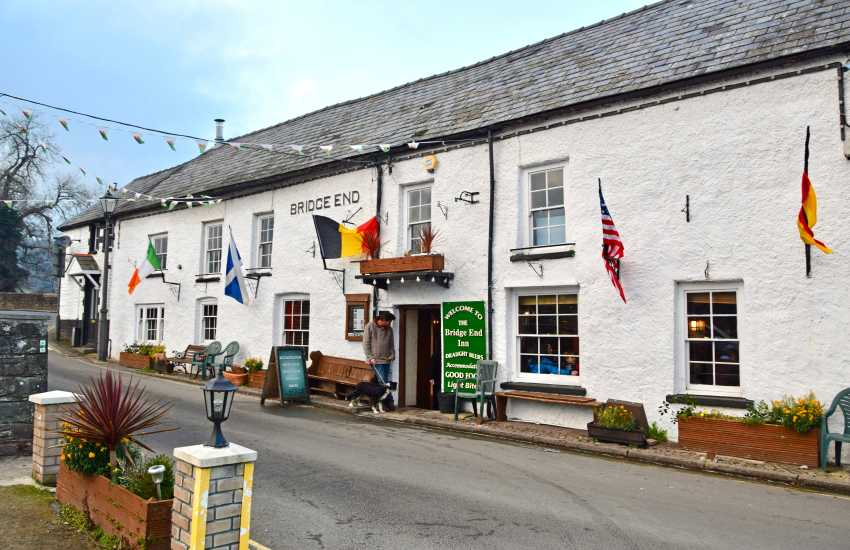 Enjoy a welcome drink at The Bridge Inn and see the longest stone bridge in Wales