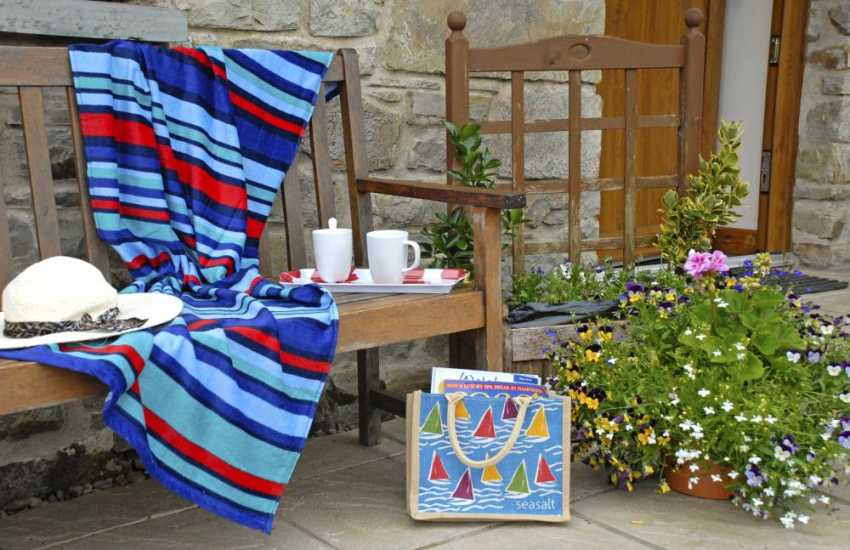 Relax with coffee on the sheltered bench at Murmur y Ceri