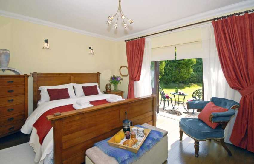 Cardigan Bay holiday cottage - 5' double bedroom with french doors to the garden