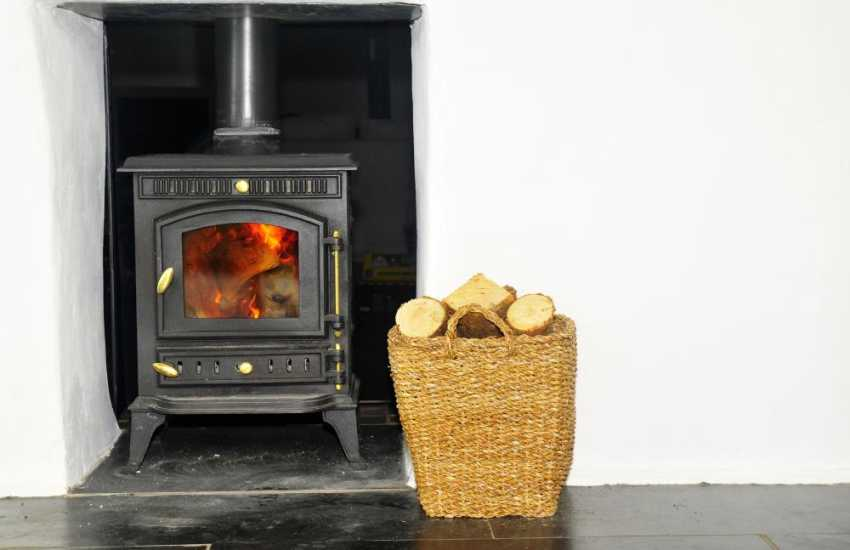 Shell Island holiday home - Conservatory with log burner