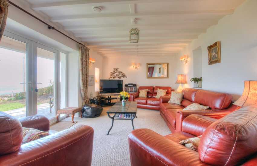Sitting room with log burner and panoramic views of Snowdonia and Cardigan Bay