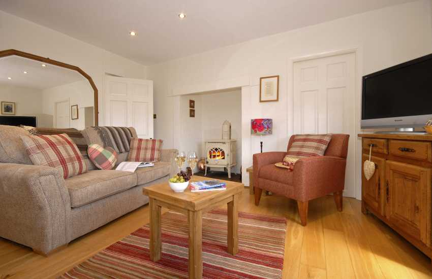 North Pembrokeshire holiday cottage - open plan sitting room with log burning stove
