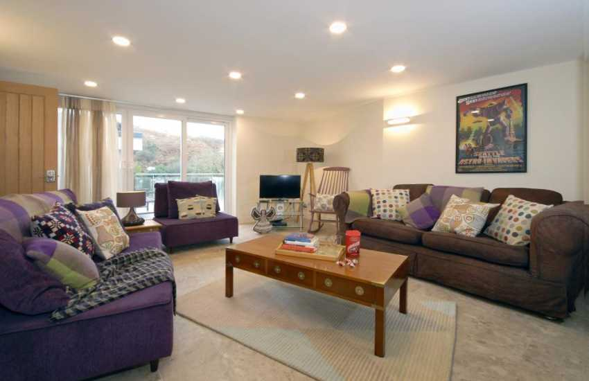 Broad Haven family holiday home - ground floor sitting room with patio doors and twin bedroom