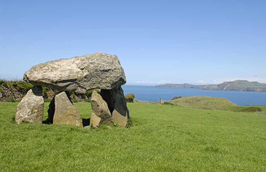Carreg Samson, west of Abercastle, is an exposed Neolithic burial chamber. Legend has it that St Samson placed the capstone in position using only his little finger