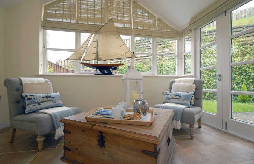 Conservatory with french doors to garden