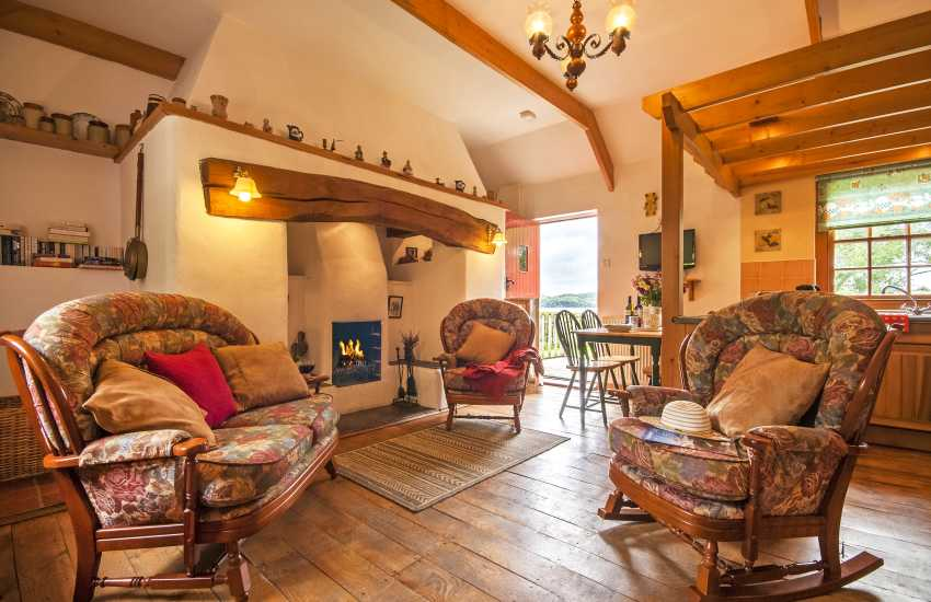 Landshipping holiday cottage open plan sitting room with inglenook and open fire - pets welcome