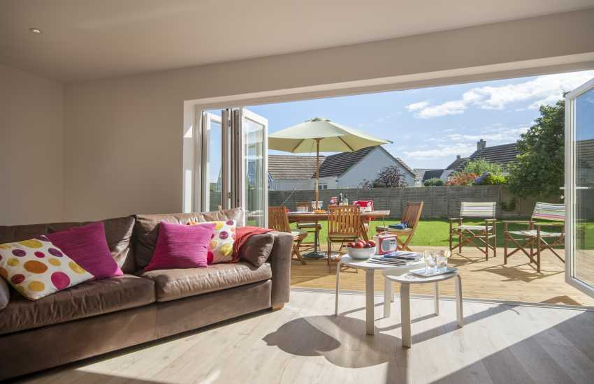 St Davids comfortable holiday home with bi folding doors to the gardens