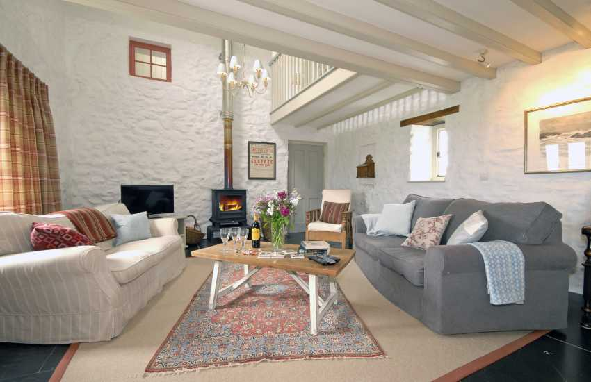 Living room with galleried landing and log burning stove