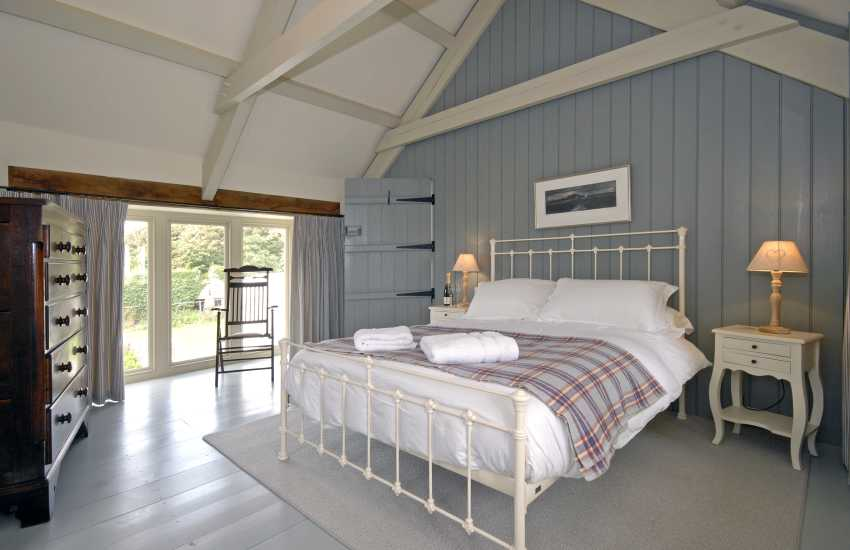 King size bedroom with coastal views