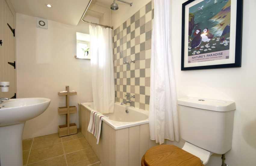 Ground floor family bathroom with shower over bath