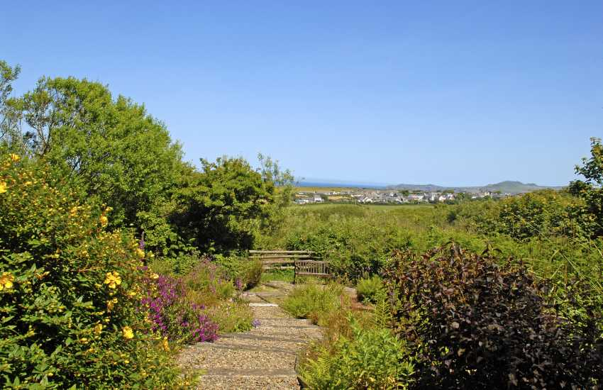 Shared gardens at Aberfelin Cottage with views to Trefin and the coast