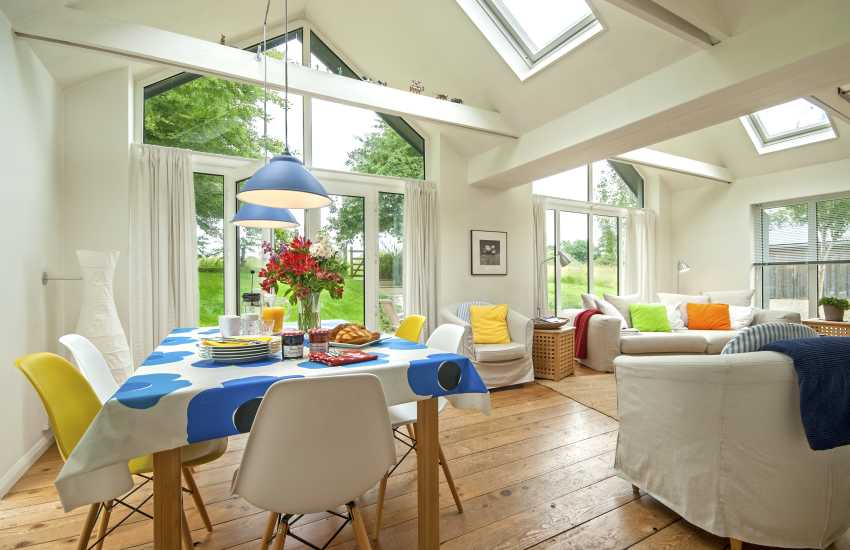 Open plan dining living room with French doors to the patio