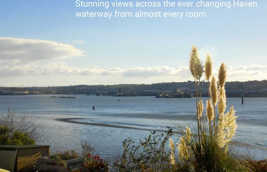 Stunning views across the ever changing Haven Waterway from almost every room in this cosy waterside home