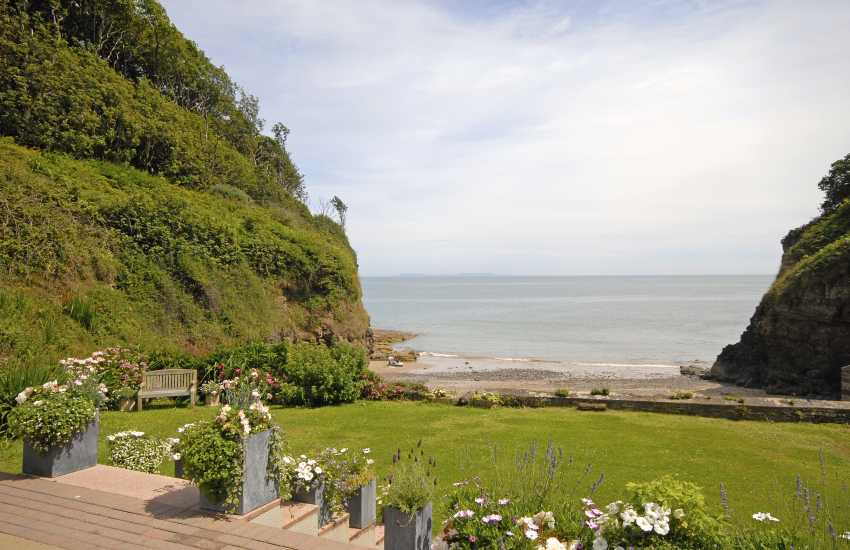 Views from the terrace over the gardens to the sea