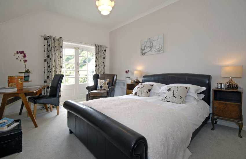 Leather - king size bedroom with balcony and en suite shower