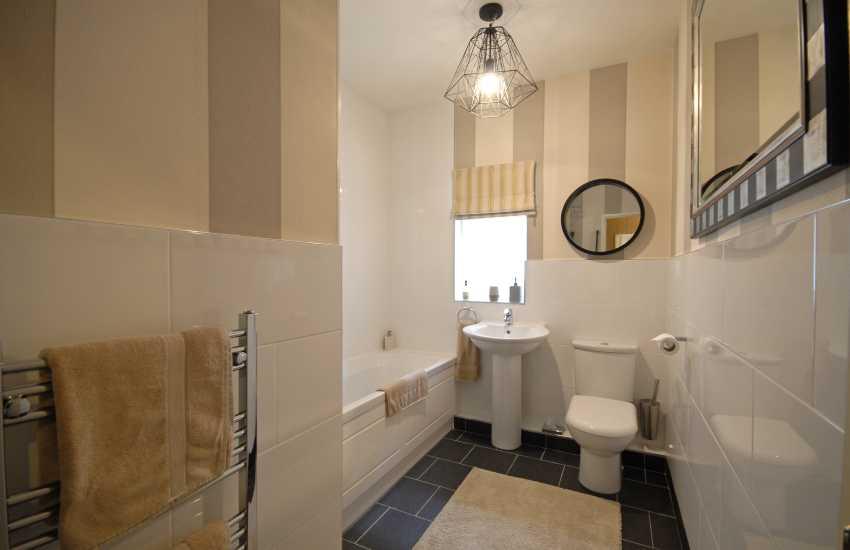 Master Balcony en suite bathroom with shower over bath