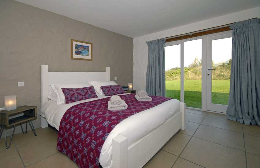 Double (upper ground floor) en suite bedroom with super kingsize bed and garden views