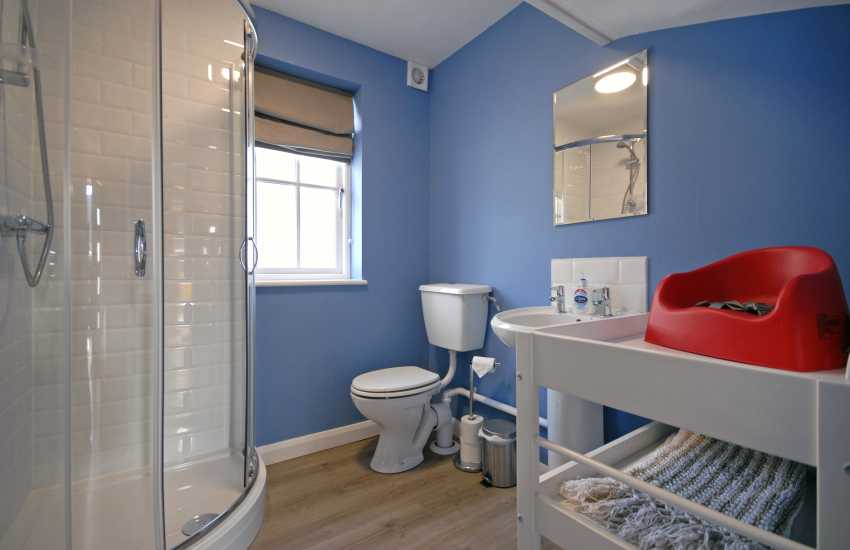Ground floor shower room with baby changing unit