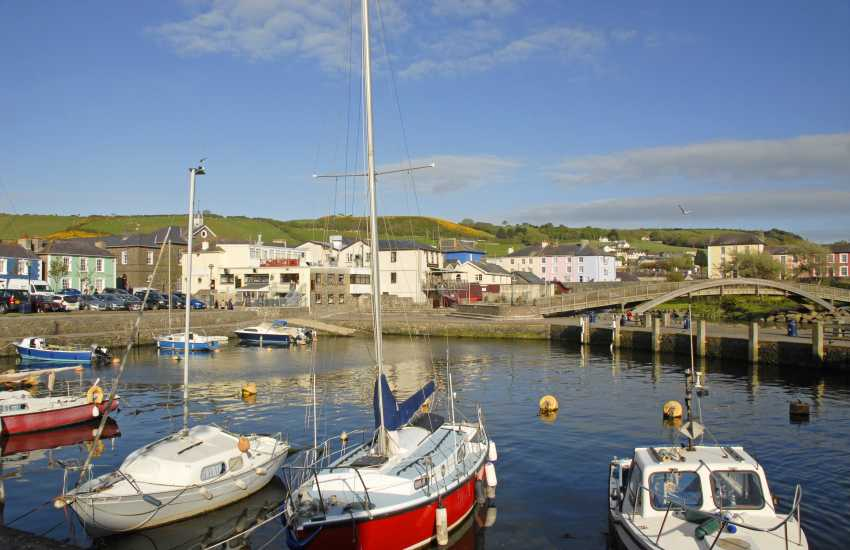 Aberaeron with brightly painted Georgian houses overlooking the harbour is a short drive along the coast