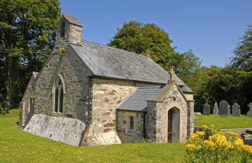 The exquisite church of St Brynach stands on a knoll opposite this Gwaun Valley manor house
