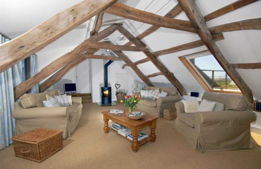 Strumble Head holiday penthouse - sitting room with wood burning stove