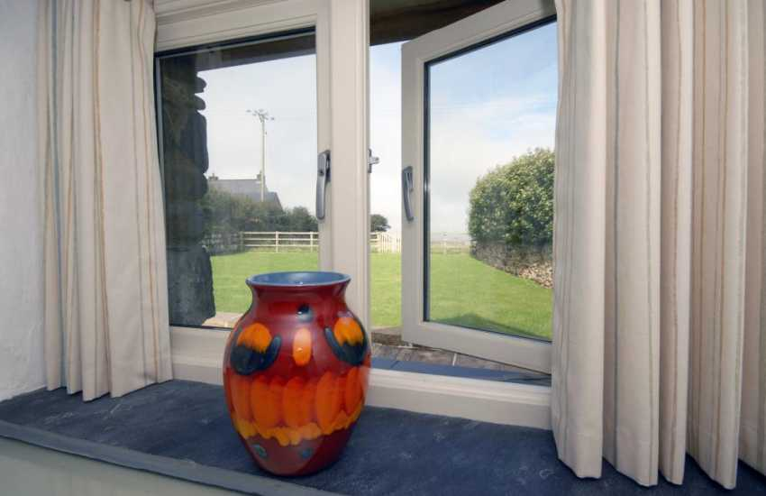 Self catering holiday cottage St Davids - king size bedroom with garden and sea views
