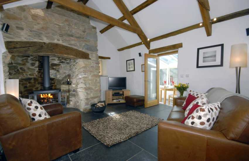 Pembrokeshire cosy holiday retreat - lounge with Ingnelnook and log burning stove