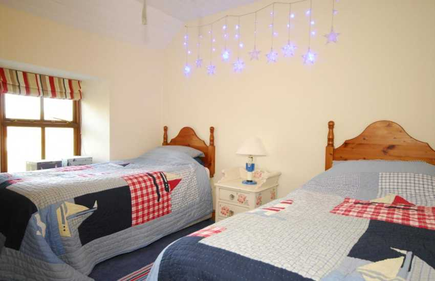 Twin Bedroom at Pwllheli holiday home sleeping 8
