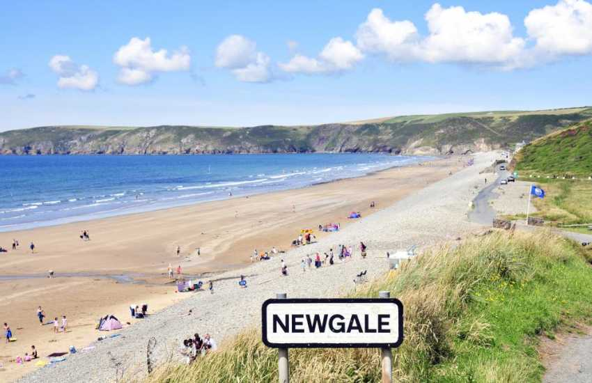 Newgale Beach (Blue Flag) is a magnificent two mile stretch of wide sand popular for surfing, kayaking, kite boarding
