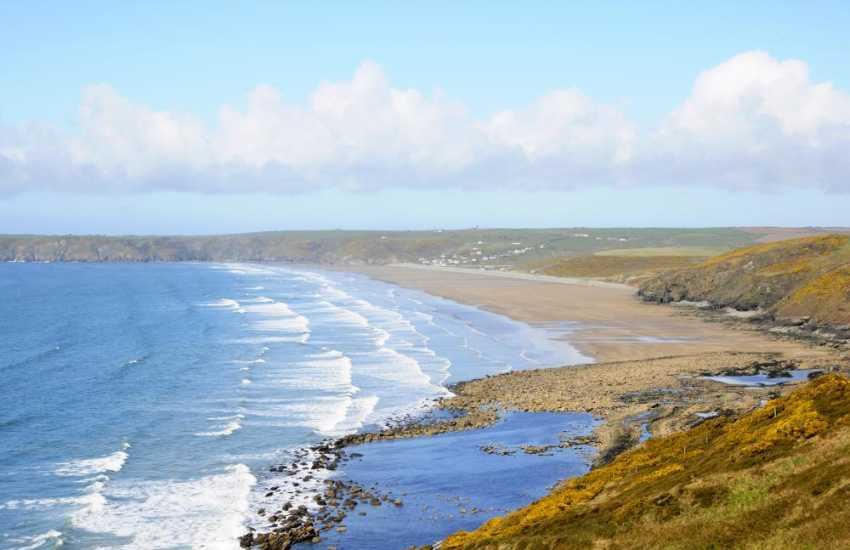 Newgale Beach on St Brides Bay - popular with families and water sport enthusiasts