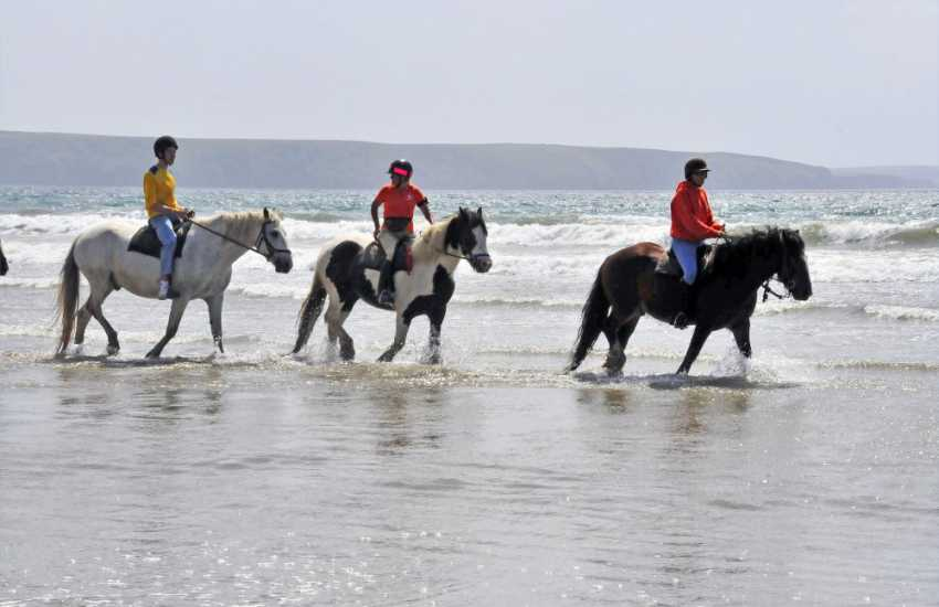 Enjoy an exhilarating beach ride through the waves or 'own a pony for a day' at nearby Marros Riding Centre